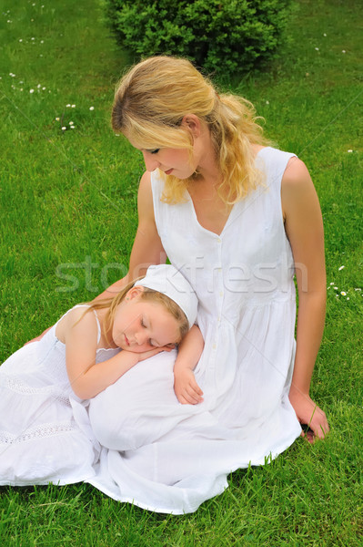 Young mother and daughter resting in meadow Stock photo © brozova