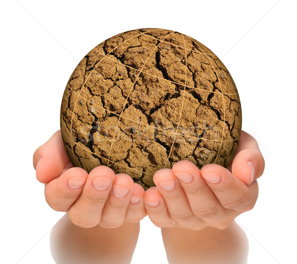 Stock photo: Parched planet in hands, global warming concept, cut out