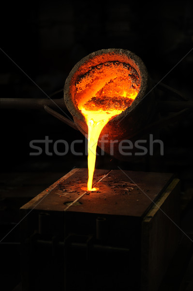 Foundry - molten metal poured from ladle into mould - lost wax casting Stock photo © brozova