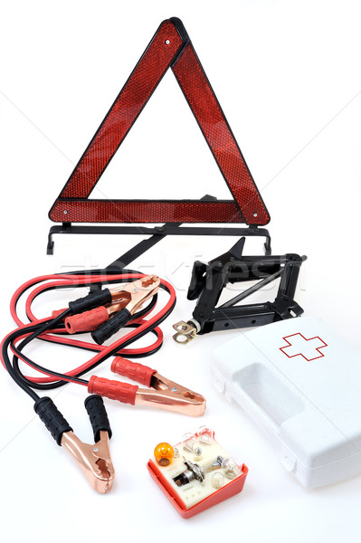 Emergency kit for car - first aid kit, car jack, jumper cables, warning triangle, light bulb kit Stock photo © brozova