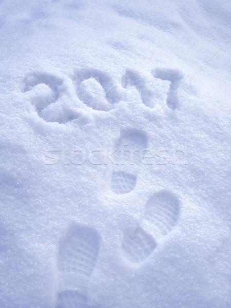 2017 New Year greeting card, 2017 new year, foot step prints in snow, happy new year 2017 concept  Stock photo © brozova