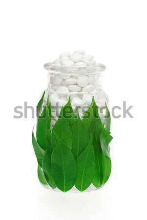 Herbal supplement pills in pill bottle – alternative medicine concept Stock photo © brozova