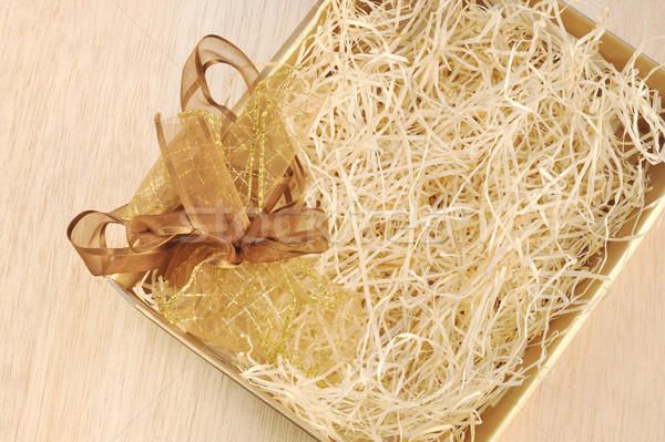 Open gift box and bow - filled with packing bast Stock photo © brozova