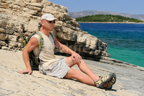 Outdoor man resting on rock after hiking, Croatia Stock photo © brozova