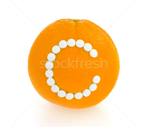 Orange with vitamin c pills over white background - concept Stock photo © brozova