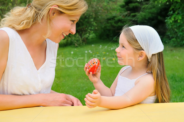 Young mother and daughter having Easter time Stock photo © brozova