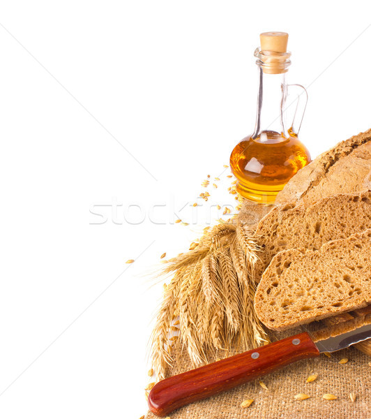 Stock photo: Domestic rye bread ears and oil