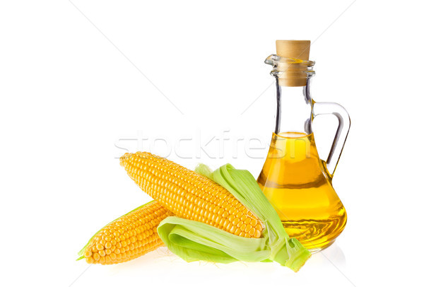 Decanter with farm organic vegetable oil and pair juicy corn cob Stock photo © brulove