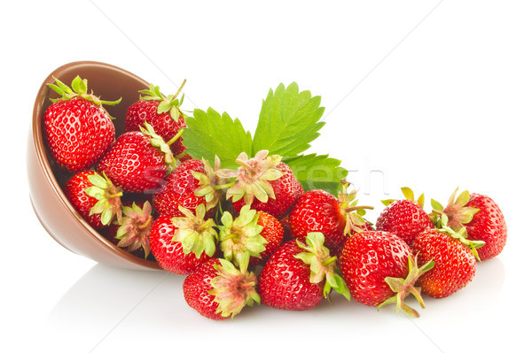 Ripe organic strawberries in tureen with green leaves Stock photo © brulove
