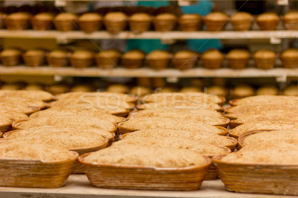 Proving dough of bran in basket. Private Bakery.  Stock photo © brulove