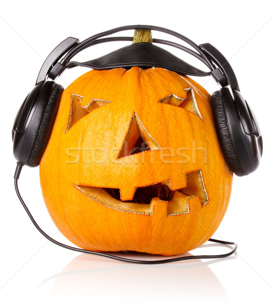 Halloween Pumpkin.Scary Jack O'Lantern in headphones Stock photo © brulove
