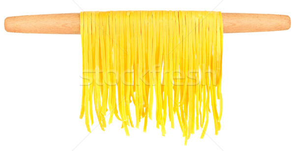 home-made noodles on wooden rolling-pin Stock photo © brulove