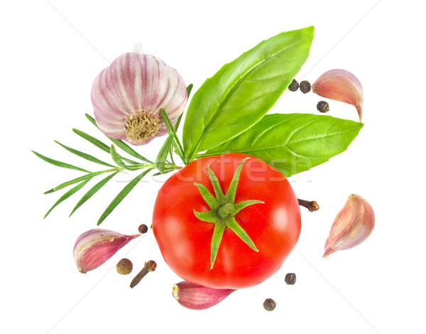 Ripe fresh tomato with herb and garlic, Stock photo © brulove