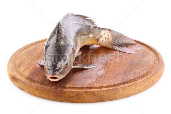 fresh fish (carp) on wooden board Stock photo © brulove