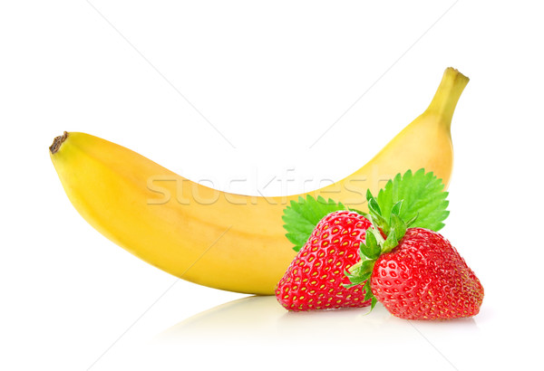 Ripe fresh banana and juicy strawberry with green leaf Stock photo © brulove