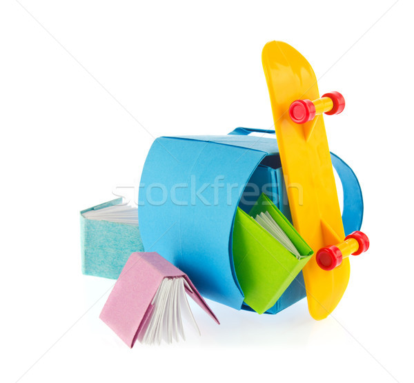 School backpack, books of origami and skate board Stock photo © brulove