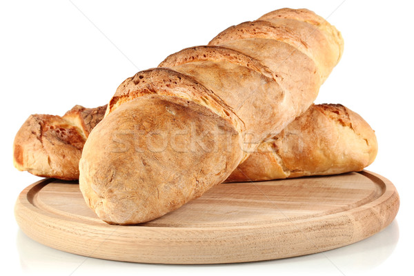 homemade bread on wooden breadboard Stock photo © brulove