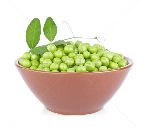 Fresh organic green pea with leaf in ceramics plate Stock photo © brulove