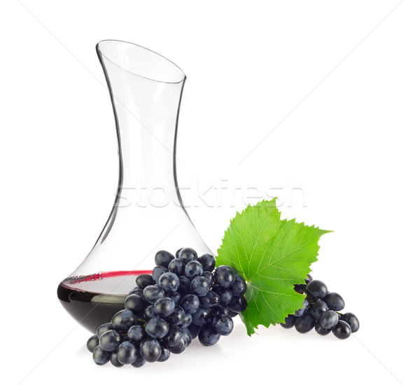 Glass decanter with red organic wine and blue grapes Stock photo © brulove