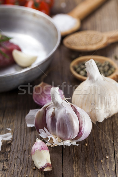 Closeup of garlic when cooking meat Stock photo © BrunoWeltmann