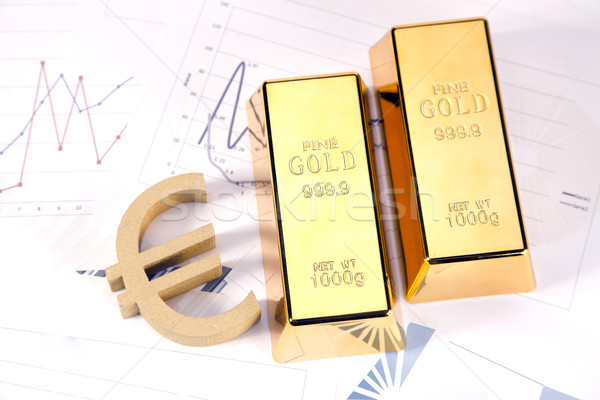 Gold bars on graphs and statistics Stock photo © BrunoWeltmann