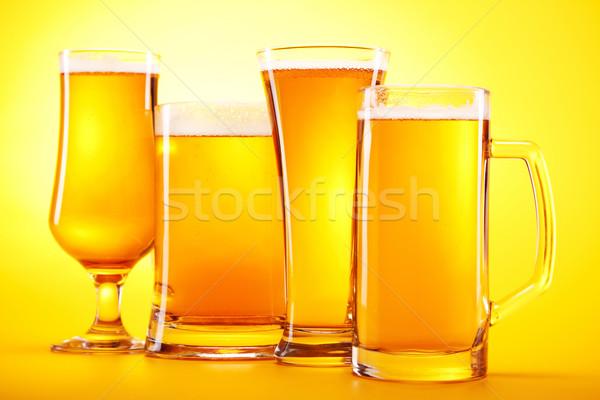 Chilled beer on yellow background Stock photo © BrunoWeltmann