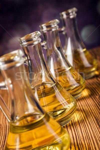 Composition of olive oils in bottles Stock photo © BrunoWeltmann