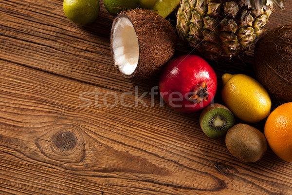 Super tasty tropical fruits on wooden table Stock photo © BrunoWeltmann