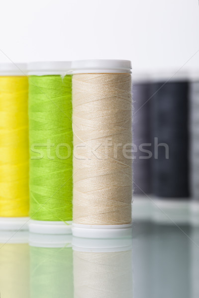 Sewing equipment and  threads on white background. Stock photo © BrunoWeltmann