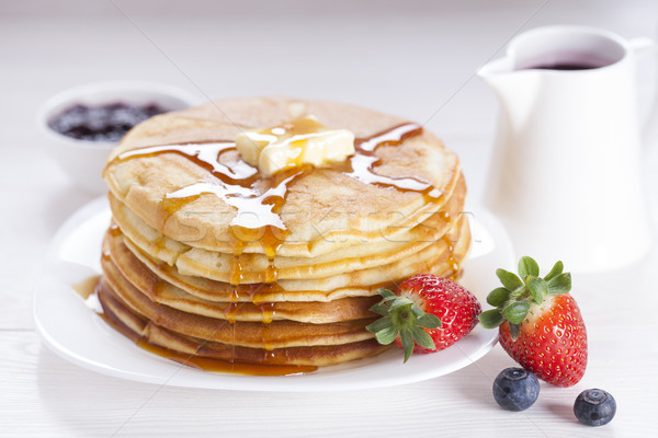 Stock photo: Delicious sweet American pancakes on a plate with fresh fruits