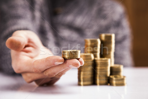 Stock photo: Men counting money! Studio shots