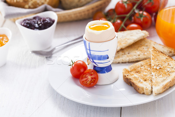 Soft-boiled egg in the morning with toast. In the background of  Stock photo © BrunoWeltmann