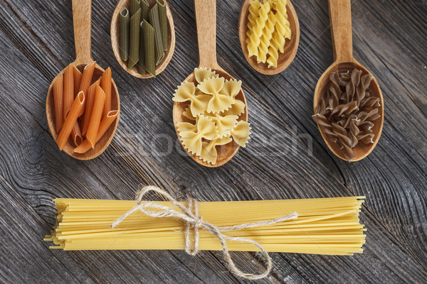 A set of raw pasta on a wooden table Stock photo © BrunoWeltmann