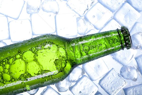 Frío cerveza hielo vidrio burbujas alcohol Foto stock © BrunoWeltmann