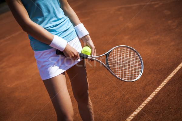 Beautiful girl smiling with a tennis racket Stock photo © BrunoWeltmann