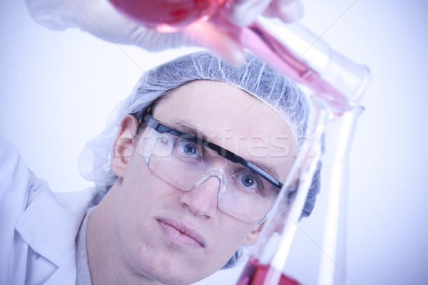 Scientist experimenting with colorfull fluids Stock photo © BrunoWeltmann