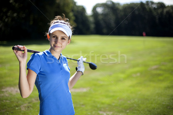 Portrait of a woman playing golf Stock photo © BrunoWeltmann