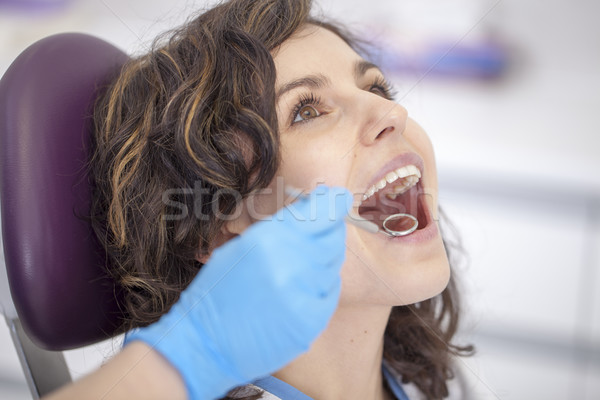 Beautiful patient in the dental chair Stock photo © BrunoWeltmann