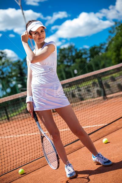 Femminile giocare tennis campo da tennis donna ragazza Foto d'archivio © BrunoWeltmann