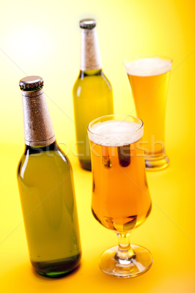 Chilled beer on yellow background Stock photo © BrunoWeltmann