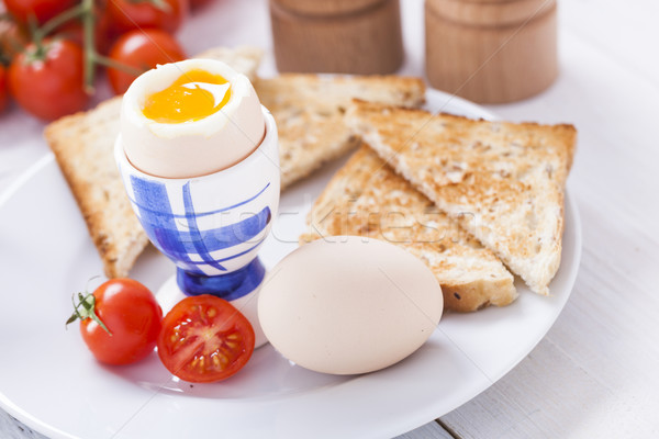 Stock photo: Soft-boiled egg in the morning with toast. In the background of
