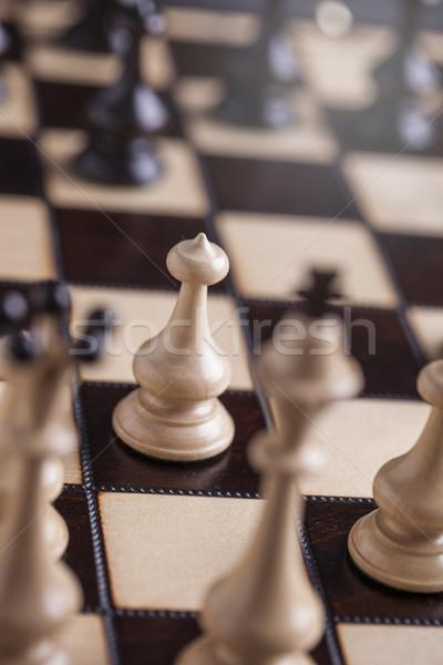 Chess pieces on a chessboard. Stock photo © BrunoWeltmann