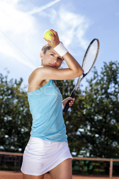 Young girl holding tennis ball on court Stock photo © BrunoWeltmann