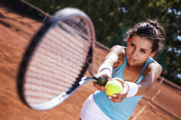 Young girl catching a ball in tennis court Stock photo © BrunoWeltmann