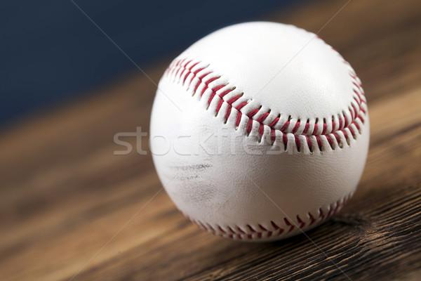Baseball ball on wooden table Stock photo © BrunoWeltmann