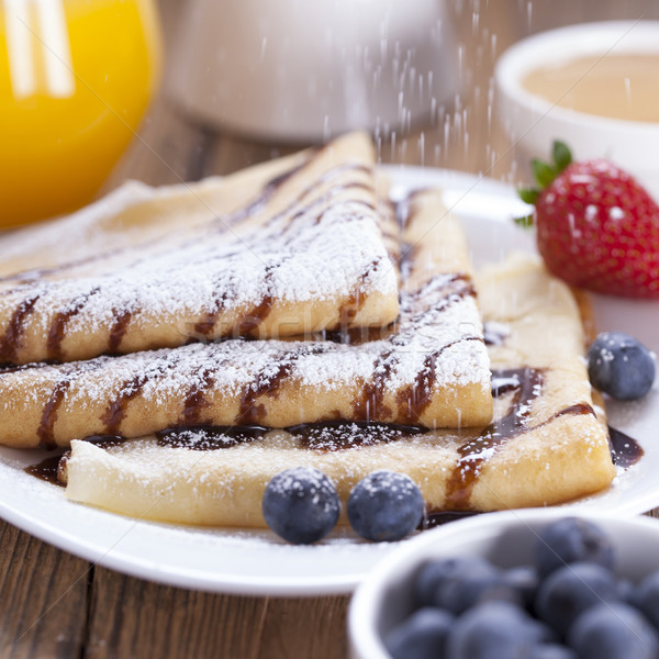 Stock photo: Delicious sweet French pancakes on a plate with fresh fruits