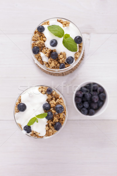 Delicious dessert, flakes flooded in two flavors yogurt with blu Stock photo © BrunoWeltmann