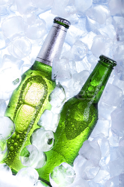 Cold beer in ice Stock photo © BrunoWeltmann