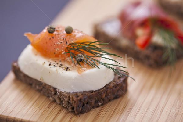 Delicioso pequeno sanduíches atum queijo prosciutto Foto stock © BrunoWeltmann