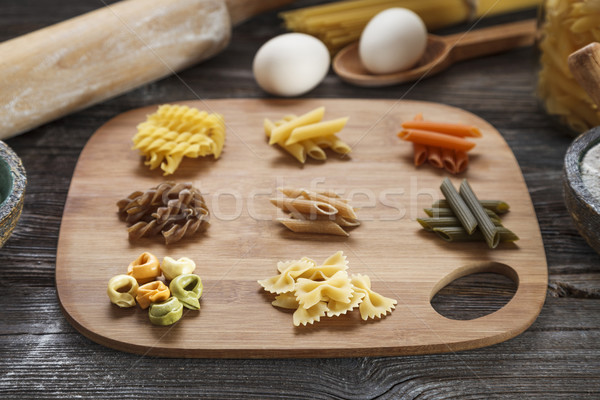 A set of raw pasta on a wooden desk Stock photo © BrunoWeltmann
